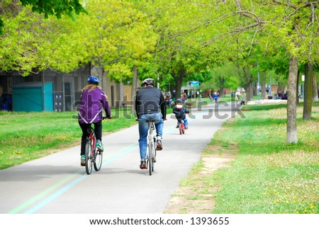 Family bicycling in a spring park