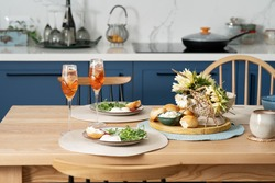 Family breakfast or brunch set served on wooden table. Scandinavian blue  kitchen and cozy home concept