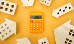 Family budget planning. Investments, plans, savings. Mortgage and mortgage rates. Real estate concept. Refinance home. Wooden houses and calculator 2021