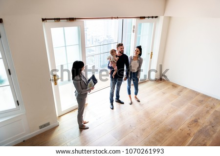 Family buying new house #1070261993