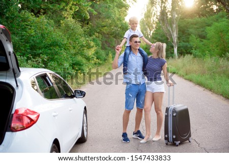Family car trip. Summer holidays, travel, road trips and people concept.