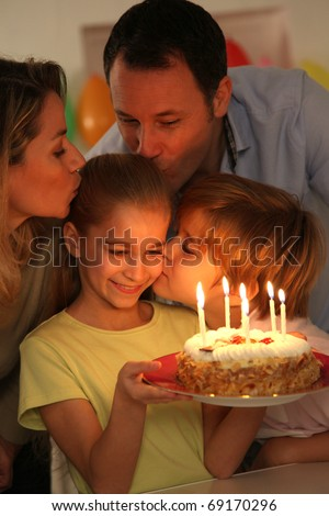Family celebrating child's birthday