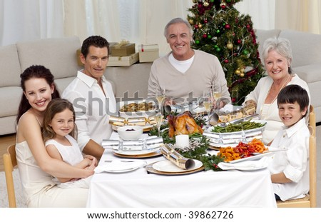 Family celebrating Christmas dinner at home