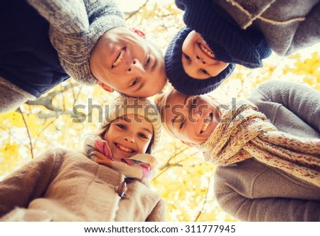 family childhood season and people concept happy family in autumn park
