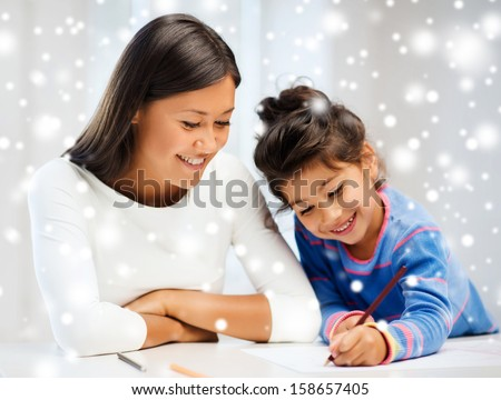 family children and happy people concept mother and daughter drawing