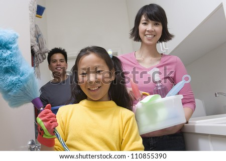 Family Cleaning Bathroom - stock photo