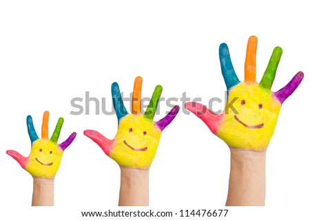 Family concept. Three colorful painted hands with smiling face of family, mother, father and baby. Small, medium and large hand. Symbol unity, growth, ready for your logo. Isolated on white background