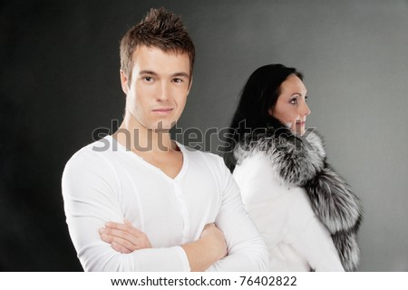 Family couple has quarreled, on gray background.