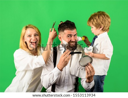 Family day. Fathers day concept. Personal stylist barber. Barbershop salon. Barbershop. Family business. Family barbershop. Bearded man in barbershop. Assistant for dad. Hairdresser and barber concept