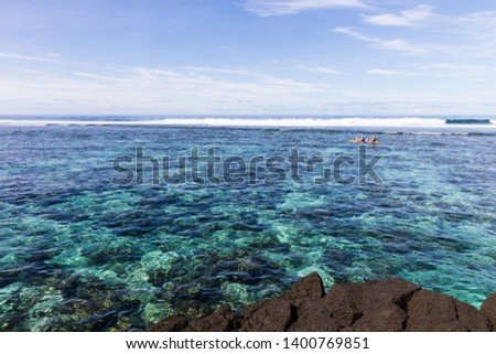Family doing watersport kayak in clear pacific ocean water in the reef on a tropical island, Samoa, Polynesia. #1400769851