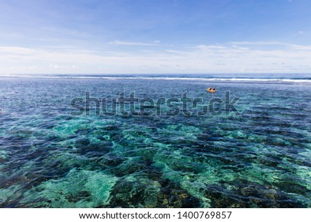 Family doing watersport kayak in clear pacific ocean water in the reef on a tropical island, Samoa, Polynesia. #1400769857