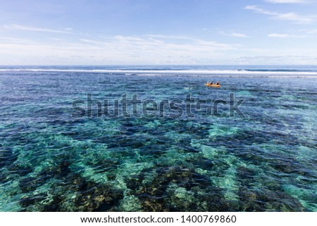 Family doing watersport kayak in clear pacific ocean water in the reef on a tropical island, Samoa, Polynesia. #1400769860