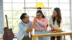 Family downs syndrome Live video clip of Wooden block toy continuation by sharing via smartphone on social media.