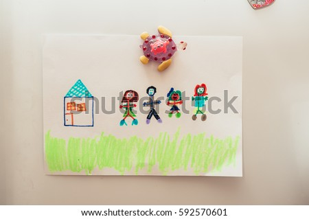 Family drawing and the house attached to the refrigerator #592570601