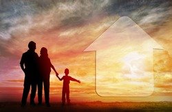 Family dream about a new house. Family house. Silhouettes against sun set.