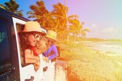 family driving off-road car on tropical beach, vacation concept
