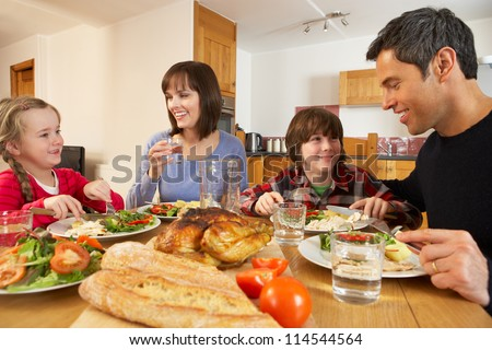 Family Eating Lunch Together In Kitchen