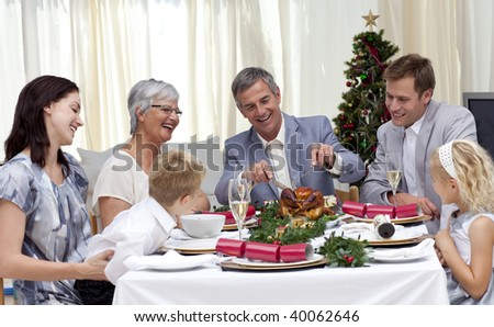 Family eating turkey in Christmas Eve at home - stock photo