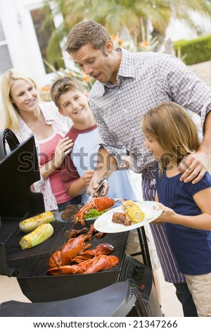 stock photo : Family Enjoying A Barbeque