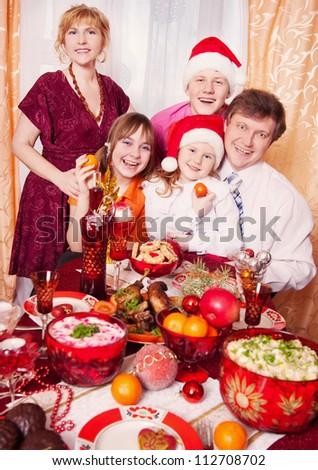 Family Enjoying Christmas Meal At Home