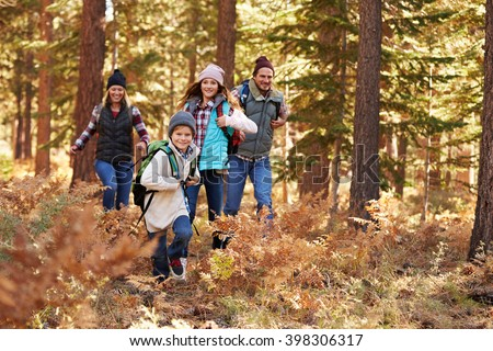 Family enjoying hike in a forest, California, USA
