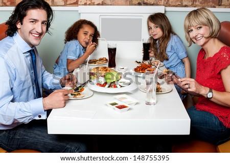 Family enjoying their dinner at a restaurant