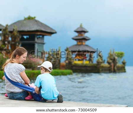 Family enjoying views of beautiful Bali water temple at Bratan lake