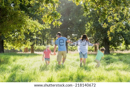 Family Enjoying Walk In Beautiful Countryside