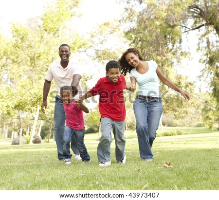 Family Enjoying Walk In Park - stock photo