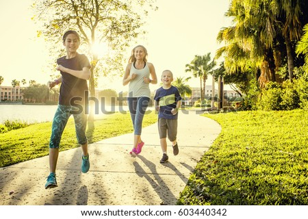 Family exercising and jogging together at the park #603440342