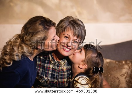 Family. Family day, mother day. Family Portrait. Happy family smiling. Daughter and child kissing grandmother. Happy family having fun at home. Young Family. Family concept