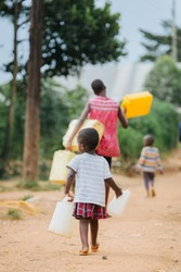 family fetching water in Uganda Africa