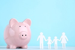 Family figures with piggybank on blue background