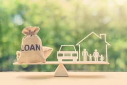 Family financial management, mortgage and payday loan or cash advance concept : Loan bags, family in a house on balance scale, depicts short term borrowing, high interest rate based on credit profile