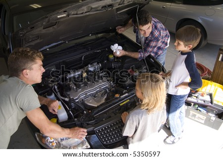 Family guys working on car