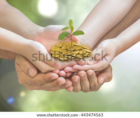 Family hand seedling money together: Parent children planting tree on gold coin on blur nature greenery background: World environment day eco bio CSR ESG ecosystem reforestation reform charity concept