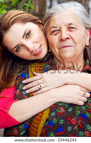 Family - happy young woman with her grandmother