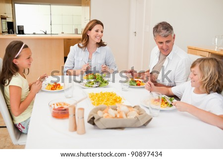 Family having a conversation together while dinner