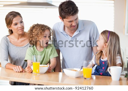 Family having breakfast in their kitchen