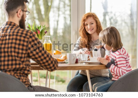 Family having breakfast together on a sunny morning
