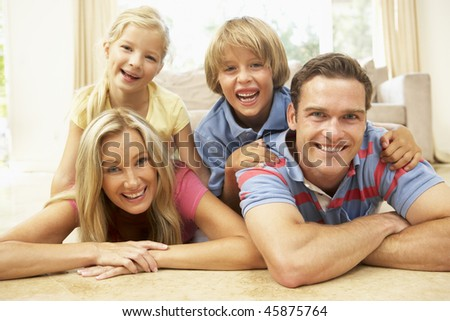 Family Having Fun At Home Together