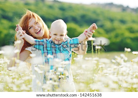 family having fun in field