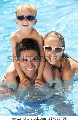 Family Having Fun In Swimming Pool
