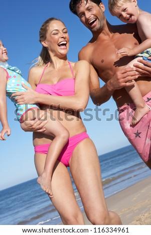 Family Having Fun On Beach - stock photo
