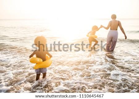 Family having fun on the beach #1110645467