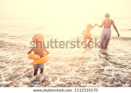 Family having fun on the beach #1112310170