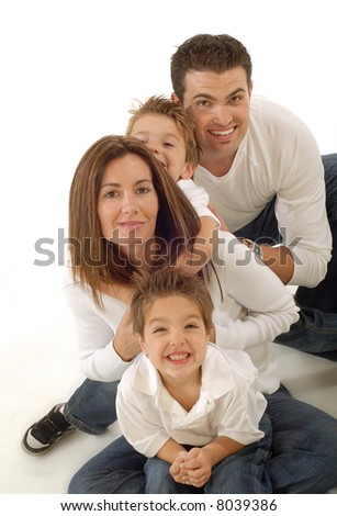 Family having fun on the floor, hugging and smiling