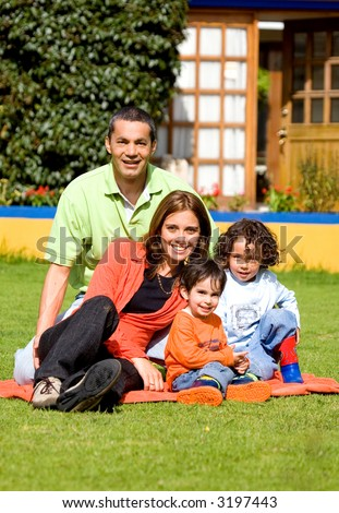 family having fun outdoors in front of their house