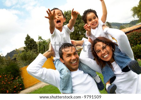 family having fun outdoors looking very happy
