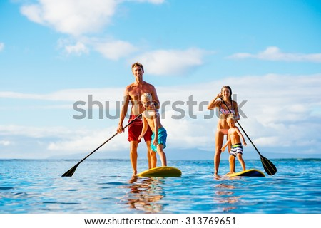 Family Having Fun Stand Up Paddling Together in the Ocean on Beautiful Sunny Morning - Shutterstock ID 313769651